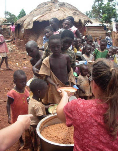 kathryn feeding Massesi children